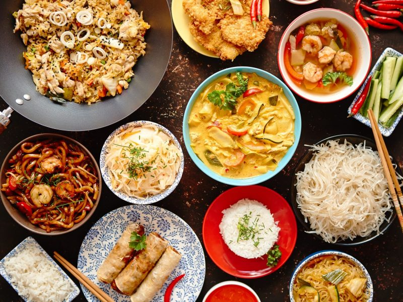 Asian oriental food composition in colorful dishware